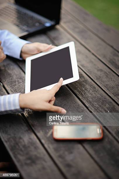 hands discussing business date on a tablet