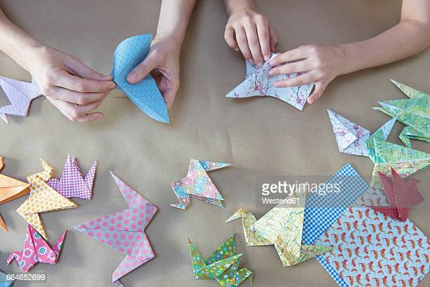 hands doing origami - family with one child stock pictures, royalty-free photos & images