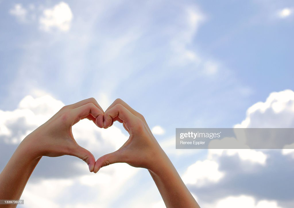 Hands formed in shape of  heart : Stock Photo