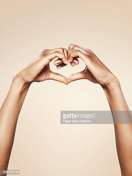 hands forming a cute heart shape - gesturing stock pictures, royalty-free photos & images