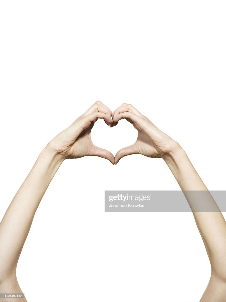 Hands forming a heart shape : Stock Photo