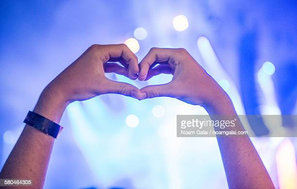 hands forming a heart shape - noam galai stock pictures, royalty-free photos & images