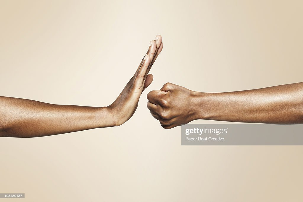 hands forming signs for offense and defense : Foto de stock