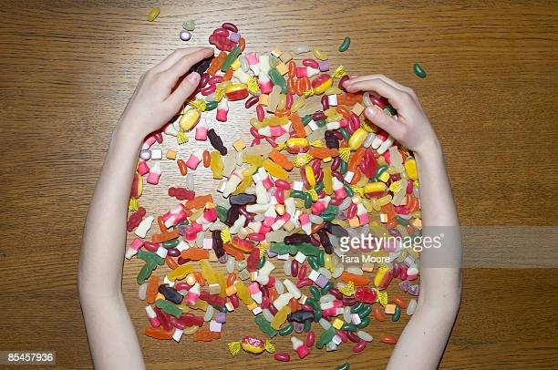 hands gathering sweets - sweet food stock pictures, royalty-free photos & images