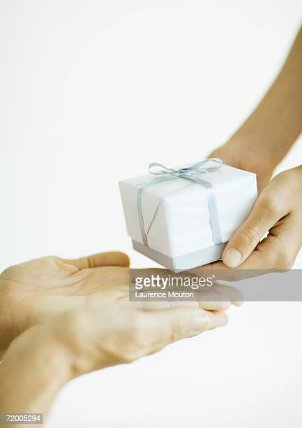 Hands giving and receiving gift