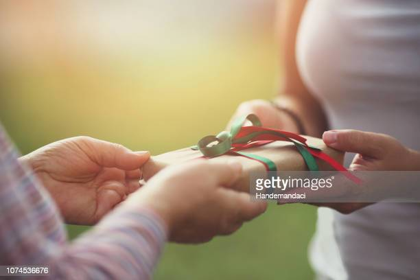 hands giving gift close-up - receiving stock pictures, royalty-free photos & images