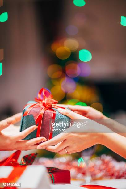 hands giving gift close-up - exchanging stock pictures, royalty-free photos & images