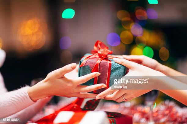 hands giving gift close-up - gift stock pictures, royalty-free photos & images