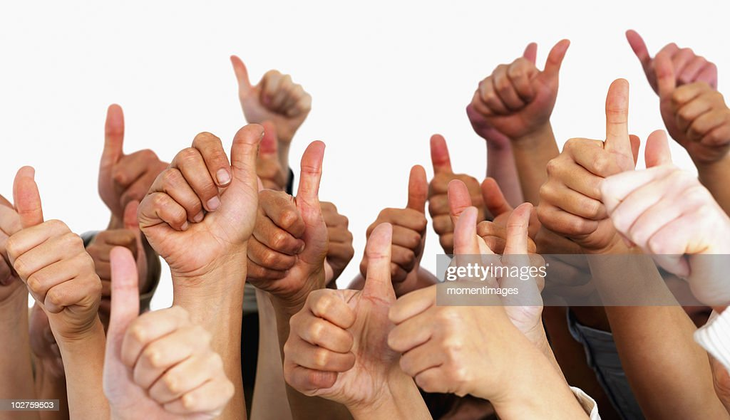 Hands giving thumbs up : Stock Photo