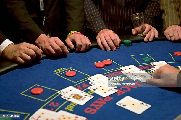 Hands gripped around a Blackjack table in the Lost Vagueness area at Glastonbury festival
