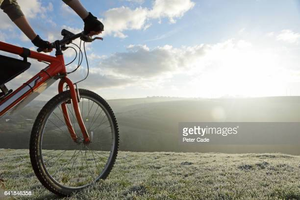 hands, handlebars, and front wheel of bike, frosty view - wheel stock pictures, royalty-free photos & images