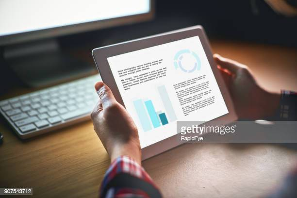 hands hold a digital tablet with unrecognizable information, at night - infographics stock pictures, royalty-free photos & images