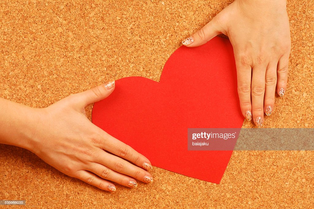 hands hold red heart : Stock Photo
