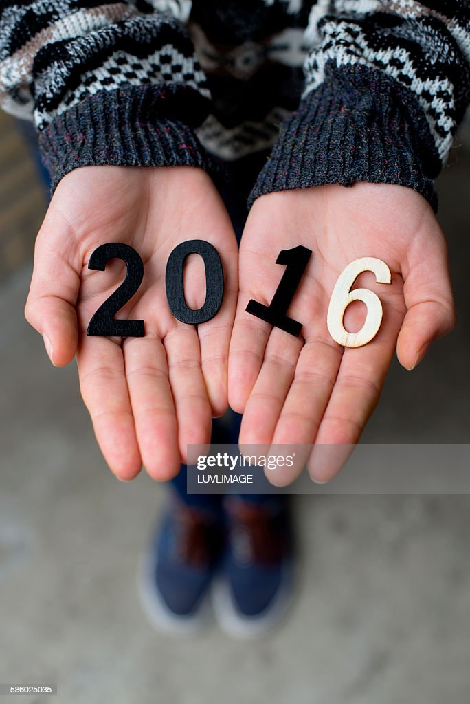 Hands holding 2016 ciphers : Stock Photo