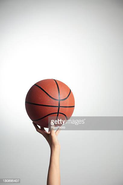 hands holding a basketball,hands close-up - single object stock pictures, royalty-free photos & images