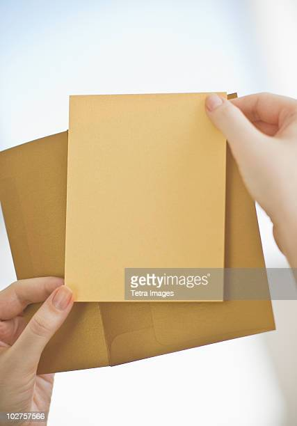 Hands holding a blank card