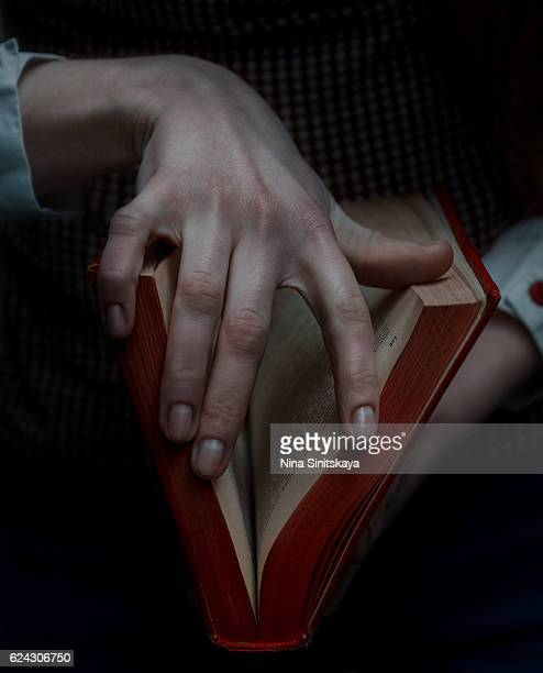 Hands holding a book whick looks like vagina, sex education