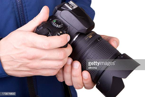 Hands holding a camera