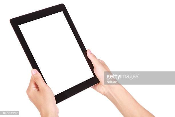 Hands holding a digital tablet
