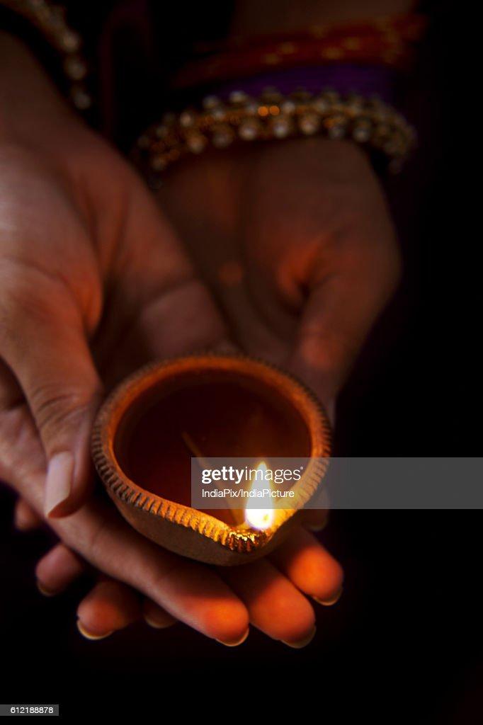 Hands holding a diya : Stock Photo