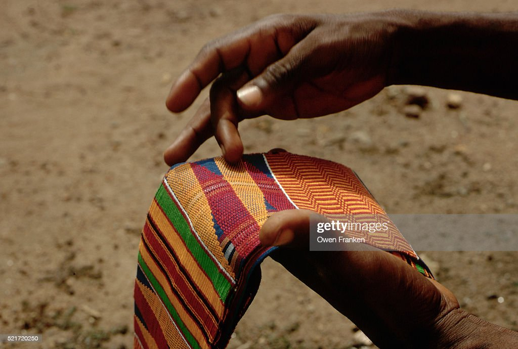 Hands Holding a Kente Cloth : Stock Photo