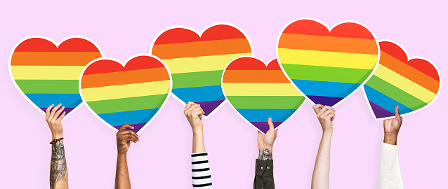 Hands holding a lgbt rainbow heart graphic 1093918450