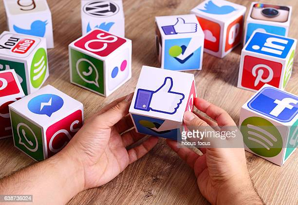 hands holding a like icon - marketing icons stock photos and pictures