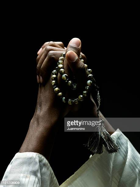 hands holding a muslim rosary - muslim praying stock pictures, royalty-free photos & images