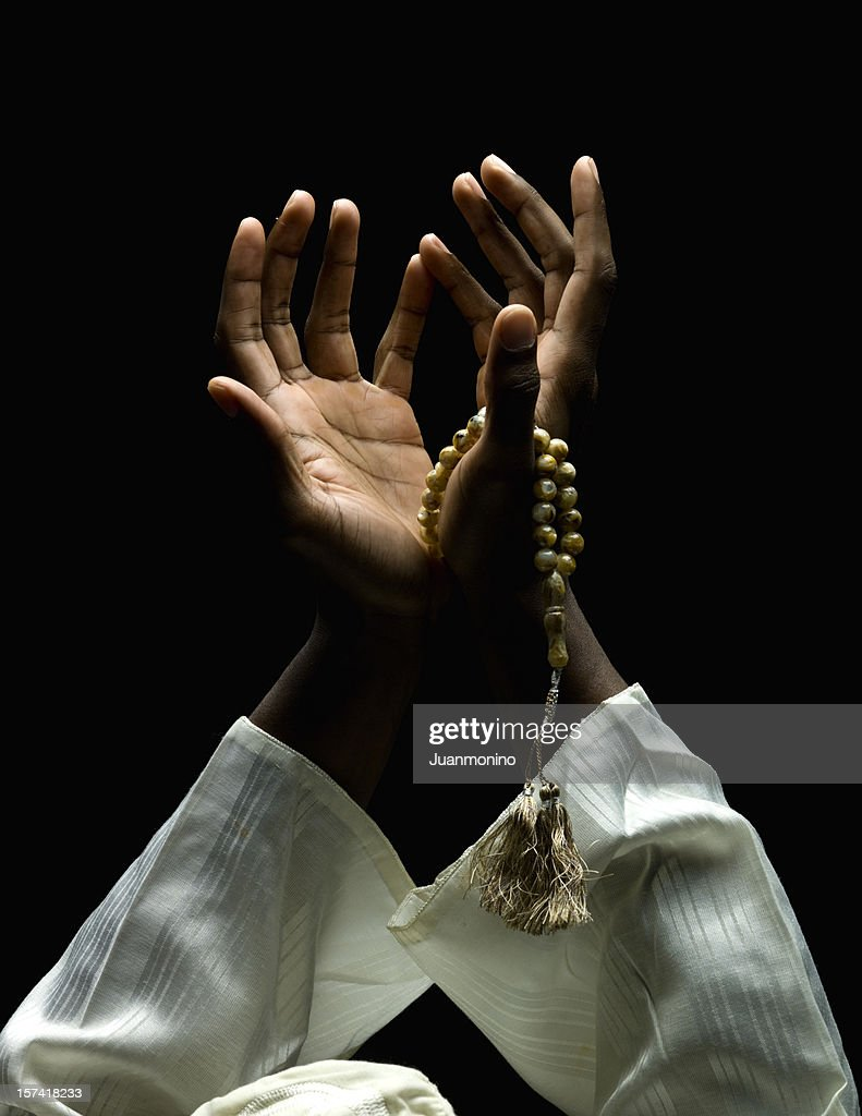 hands holding a muslim rosary : Stock Photo