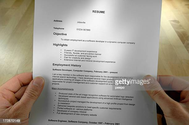 A hands holding a resume in high definition quality image