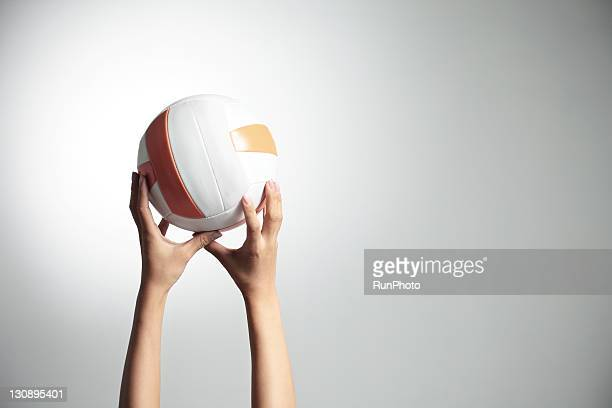 Hands holding a volleyball,hands close-up
