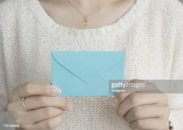 Hands holding an envelope