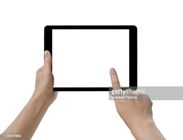 hands holding and touching on tablet pc isolated on white background - tablette photos et images de collection