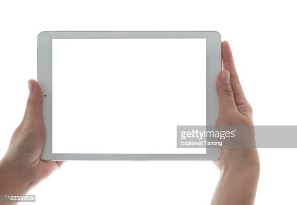 hands holding and touching on tablet pc isolated on white background - touchpad stock pictures, royalty-free photos & images