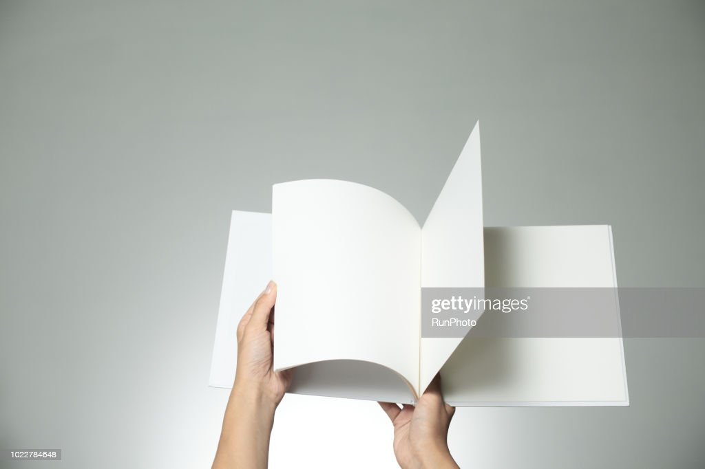 Hands holding blank book : Stock Photo
