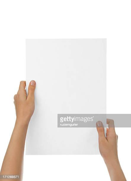 Hands holding blank paper against white background