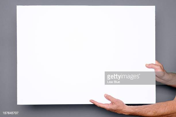 hands holding blank paper sign.copyspace - blank sign stock photos and pictures