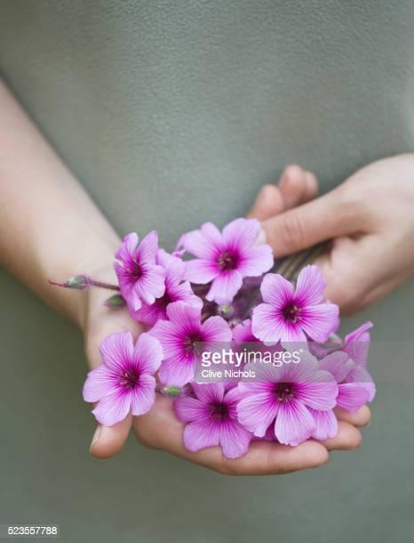 Hands holding bouquet
