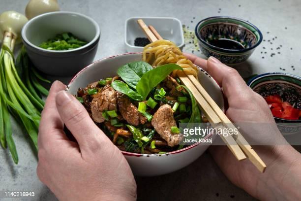 hands holding bowl - servierfertig stock-fotos und bilder