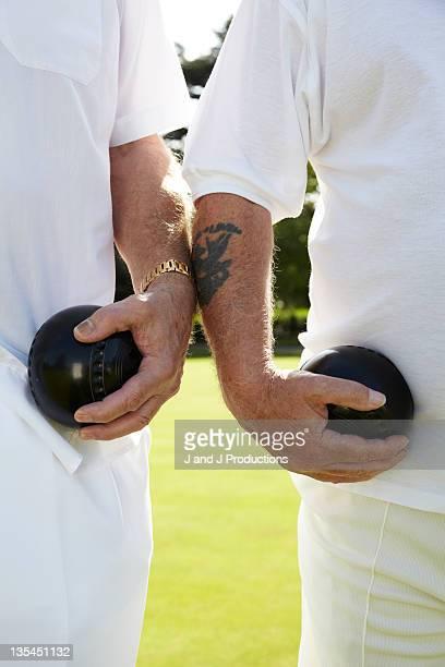Hands holding bowls