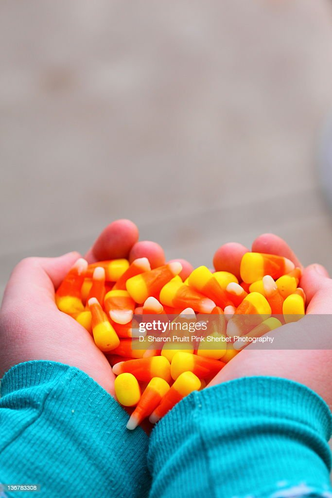 Hands holding candy corn heart : Stock Photo