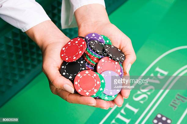 Hands holding casino chips