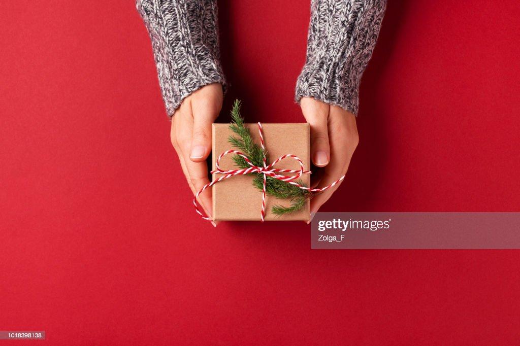 Hands holding Christmas gift box. : Stock Photo
