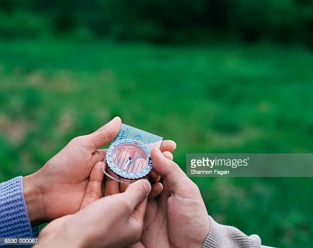 Hands Holding Compass
