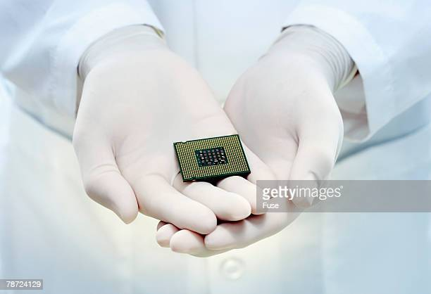Hands Holding Computer Chip