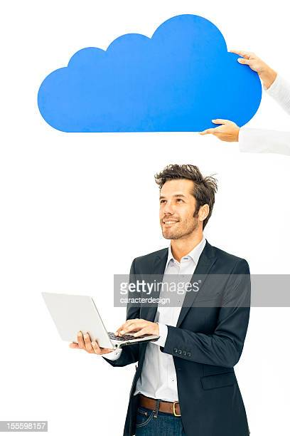 Hands holding coputing cloud over businessman