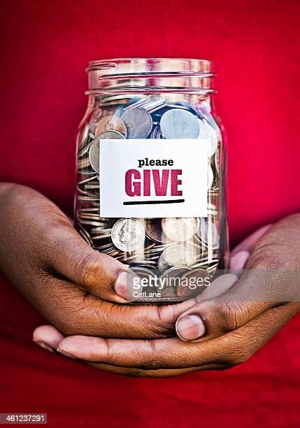 Hands Holding Donation Jar