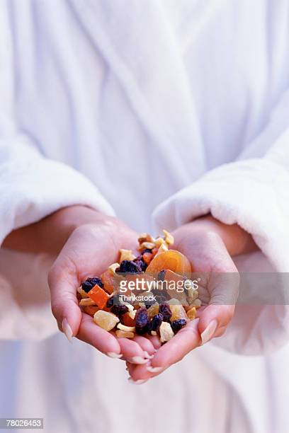 Hands holding dried fruit