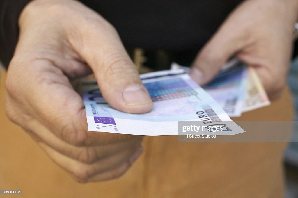 Hands holding Euro currency : Stock Photo