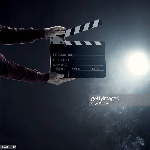 hands holding film slate - film director stock pictures, royalty-free photos & images